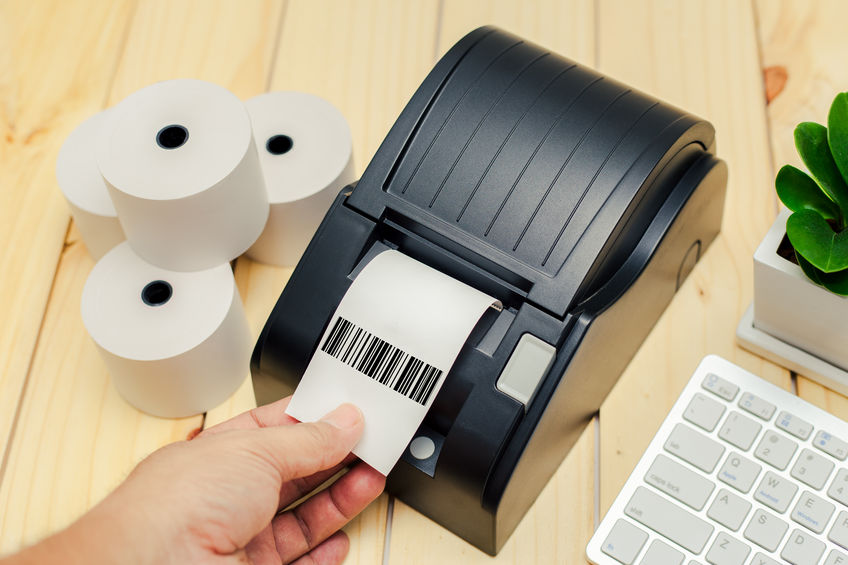 Office equipment, A point of sale receipt printer printing a receipt