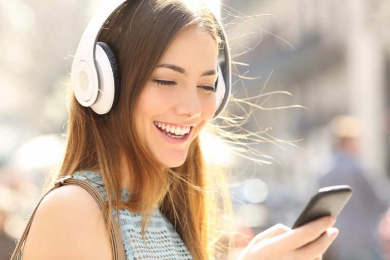 Happy girl listening music with headphones