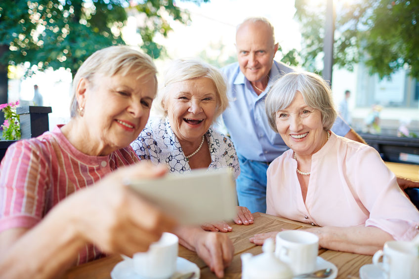 Older people taking happy selfie
